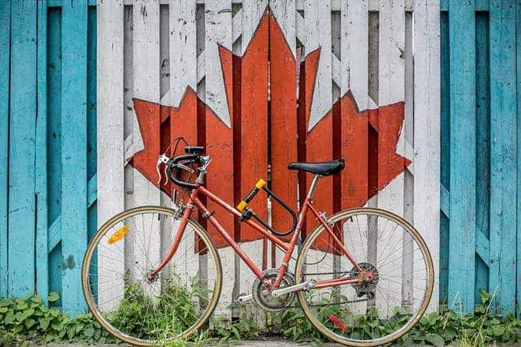 Bike against wall with Canadian maple leaf